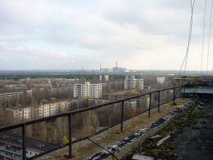 The abandoned city of Pripyat with the Chernobyl power plant in the distance