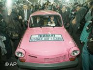 The last Trabi leaves the production line at the factory in Zwickau on 30 April 1991. (AP Photo/Eckehard Schulz)