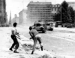 Demonstrators throwing rocks at Russian tanks in the Stalinallee during the East German Uprising of 17 June 1953. www.walled-in-berlin.com